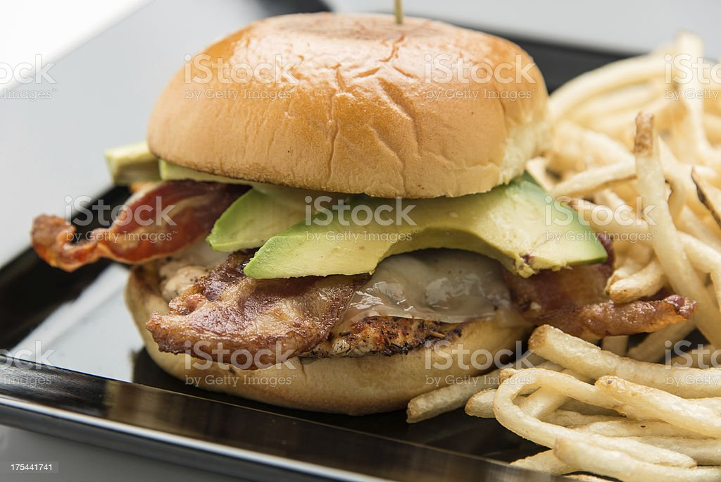 Grilled Chicken, avocado, cheese and bacon sandwich stock photo