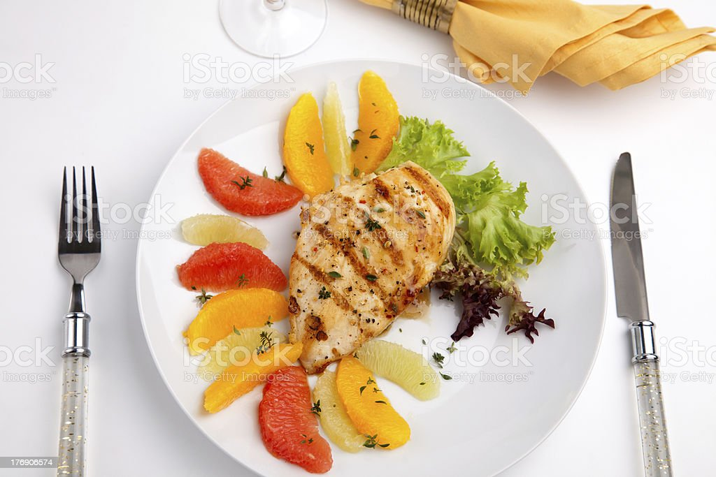 Grilled chicken breast and citrus salad royalty-free stock photo