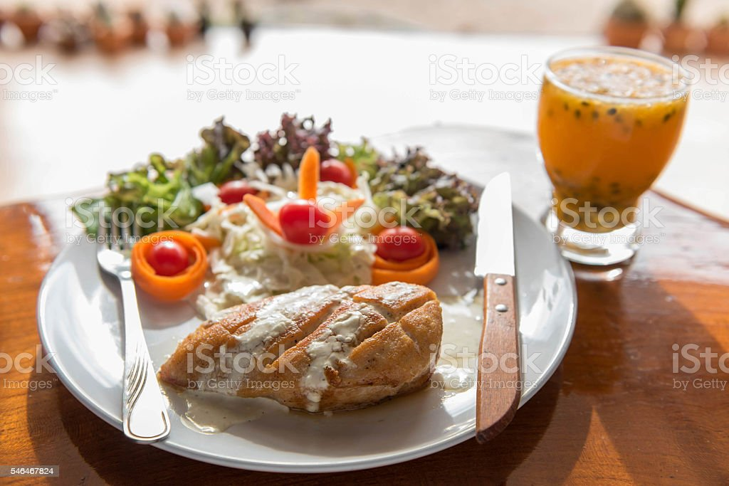 Grilled Chicken Breast And Mixed Salad Passion Fruit Juice Stock