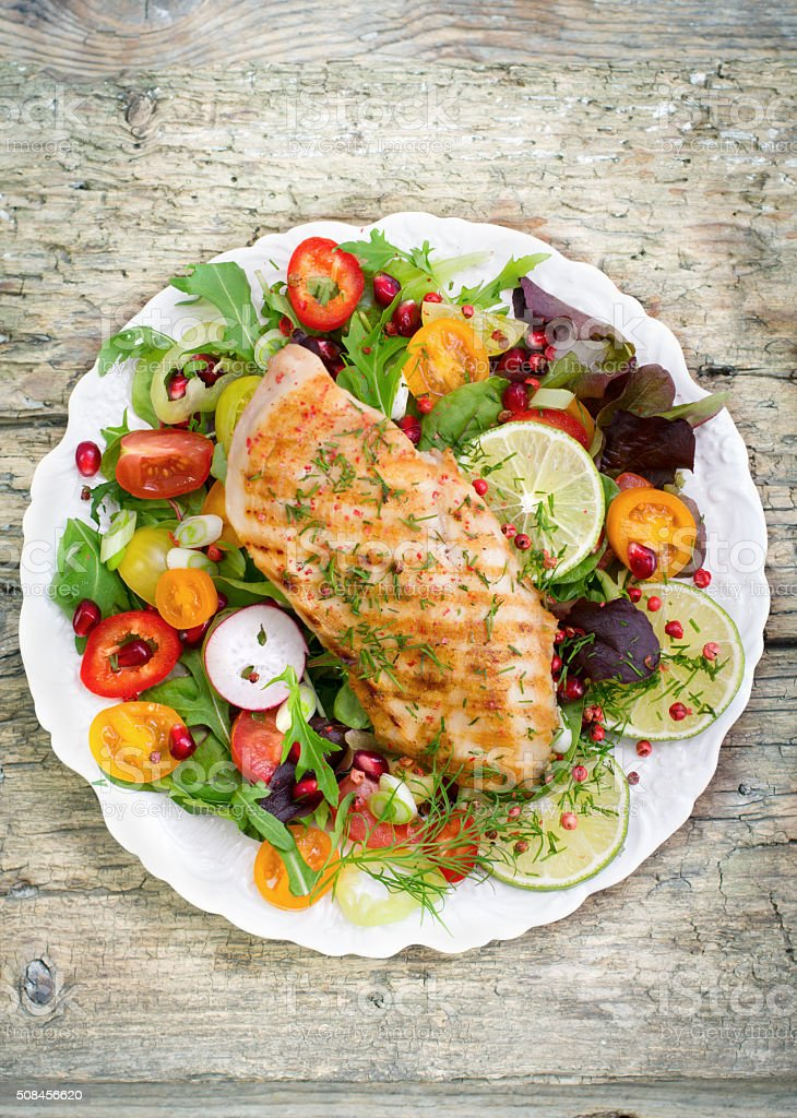 Grilled chicken breast and salad stock photo
