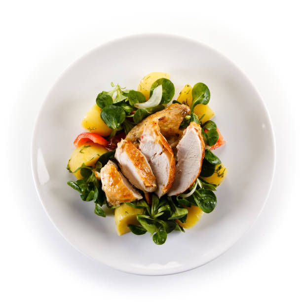 Grilled chicken breast and vegetables Grilled chicken breast and vegetables on white background grilled chicken breast stock pictures, royalty-free photos & images