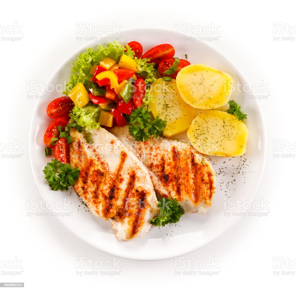 Grilled chicken breast and vegetables stock photo