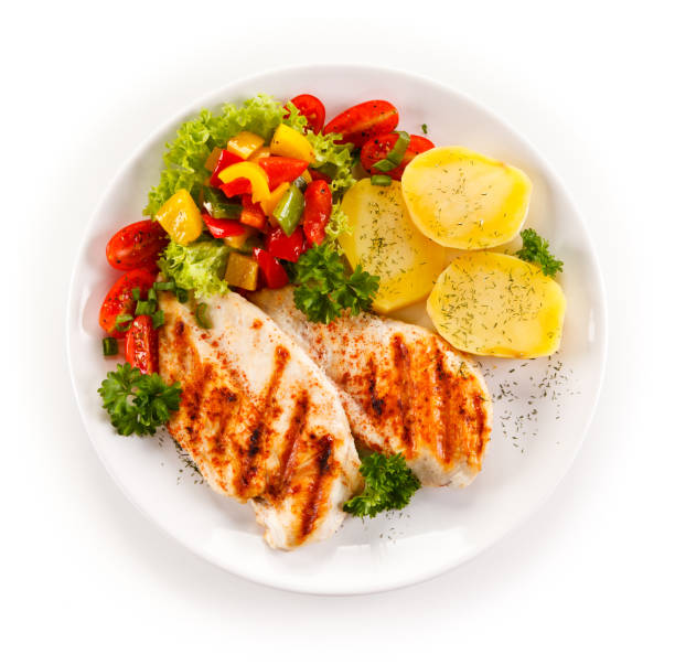 grilled chicken breast and vegetables - plate stock pictures, royalty-free photos & images