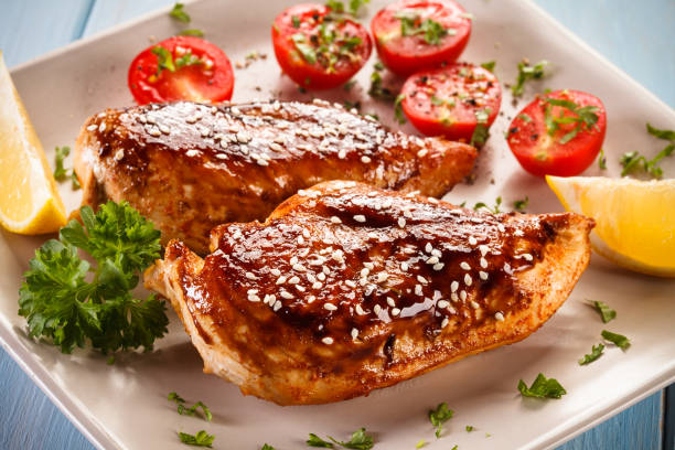 grilled chicken breast and vegetables salad - sesame stock photos and pictures