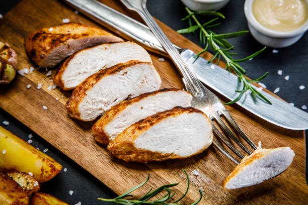 Grilled chicken breast, French fries and vegetables Grilled chicken breast, French fries and vegetables grilled chicken breast stock pictures, royalty-free photos & images