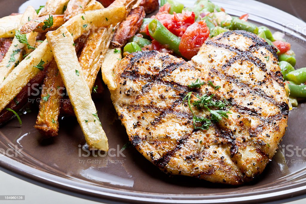Grilled Chicken Breast Green Beans and French Fries royalty-free stock photo