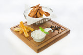 istock Grilled chicken breast nuggets with dip sauce on wooden table 1196719273