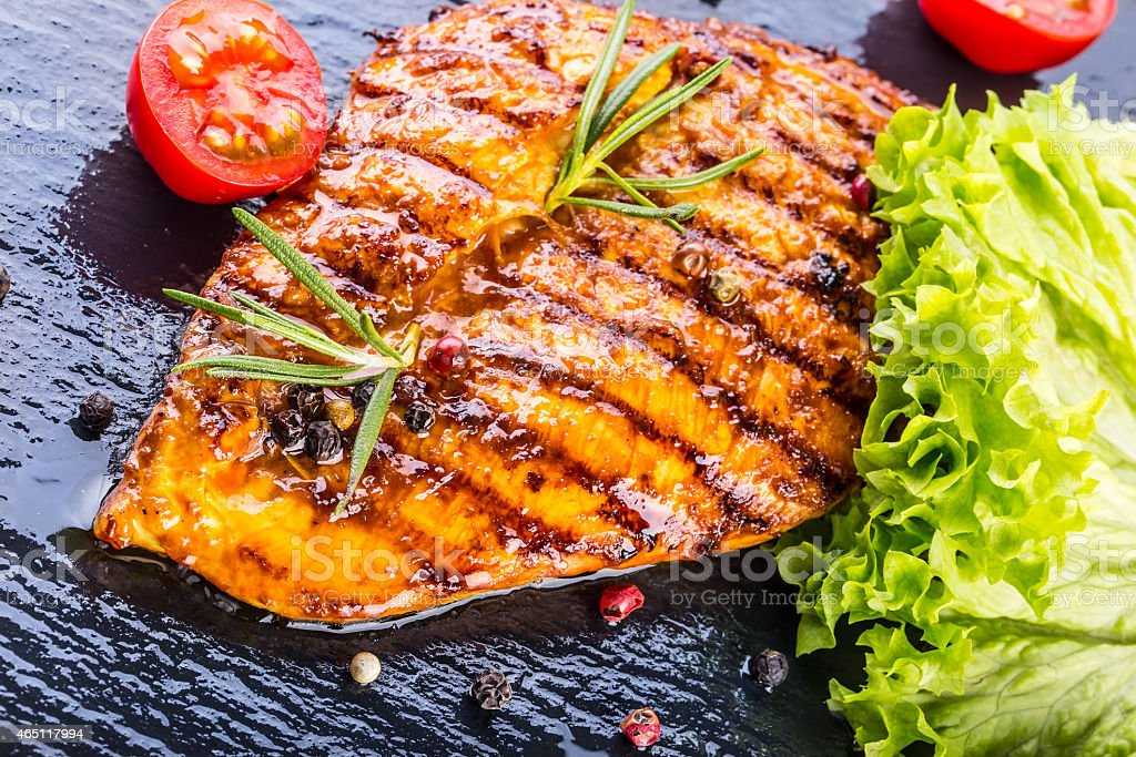 Grilled chicken breast on granite board  stock photo