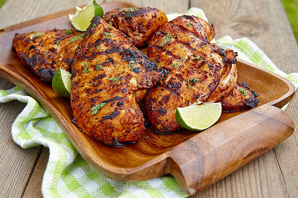 Grilled chicken breast with lime stock photo