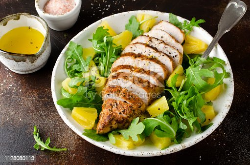 istock Grilled chicken breast with pineapple and arugula 1128080113