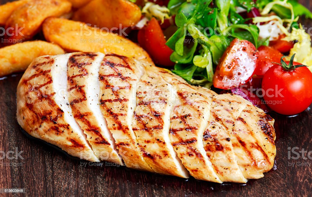 Grilled Chicken breast. with potato and vegetables stock photo