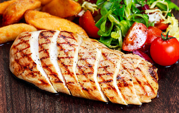 Grilled Chicken breast. with potato and vegetables Grilled Chicken breast. with potato and vegetables. grilled chicken breast stock pictures, royalty-free photos & images