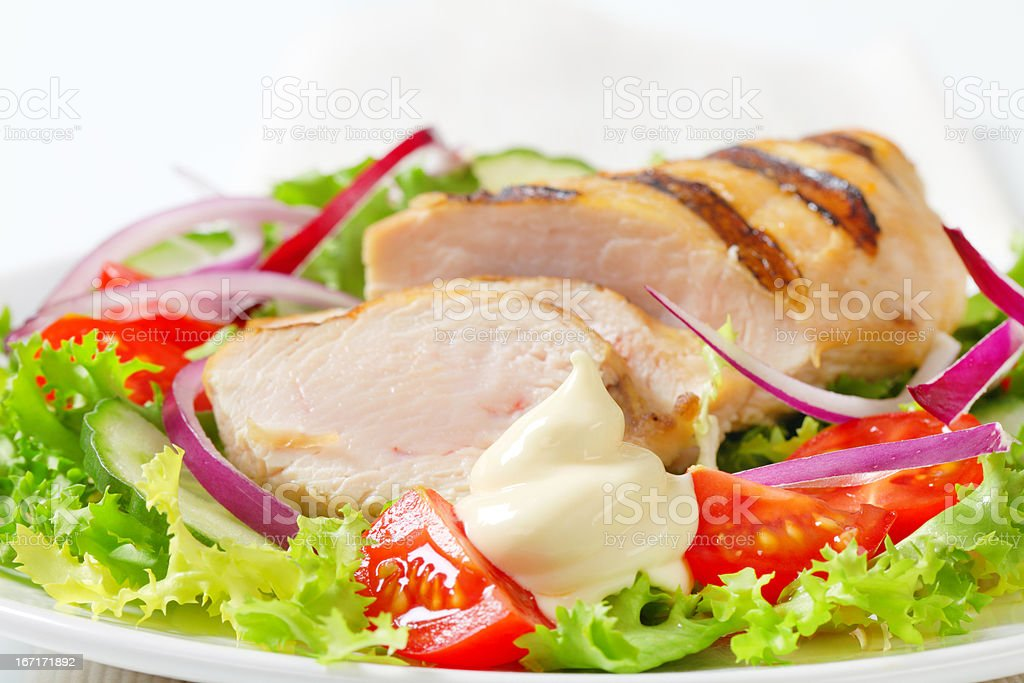 grilled chicken breast with vegetable garnish stock photo