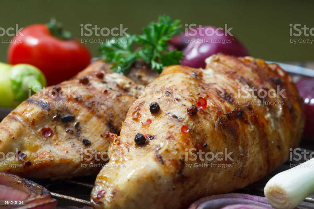 Grilled chicken breasts cooked on a BBQ royalty-free stock photo