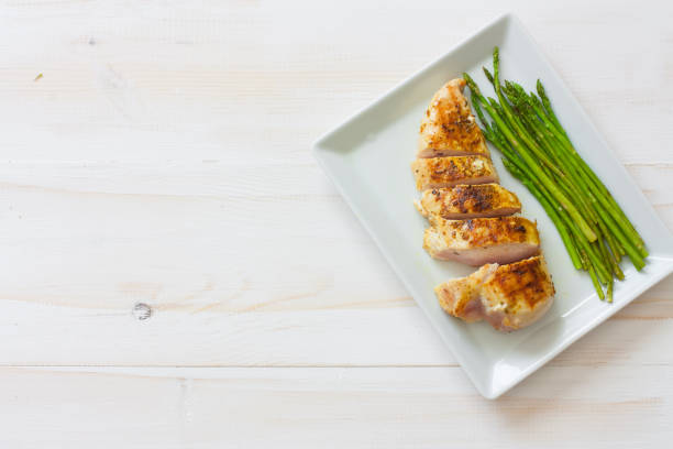 Grilled chicken fillet and asparagus stock photo