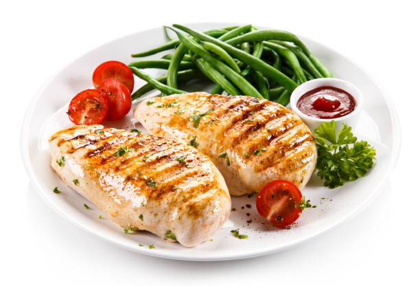 Grilled chicken fillet and vegetables stock photo