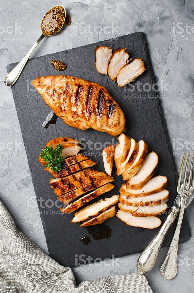 Grilled chicken fillets in a spicy marinade - Photo