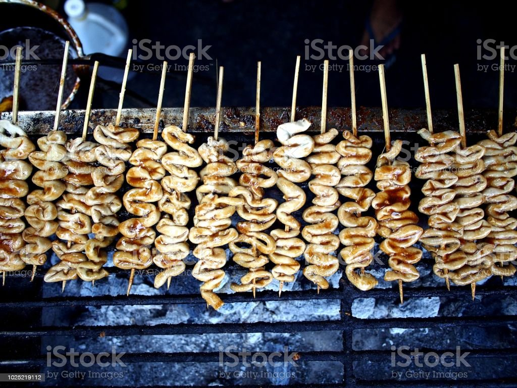 Grilled chicken intestine on a stick stock photo