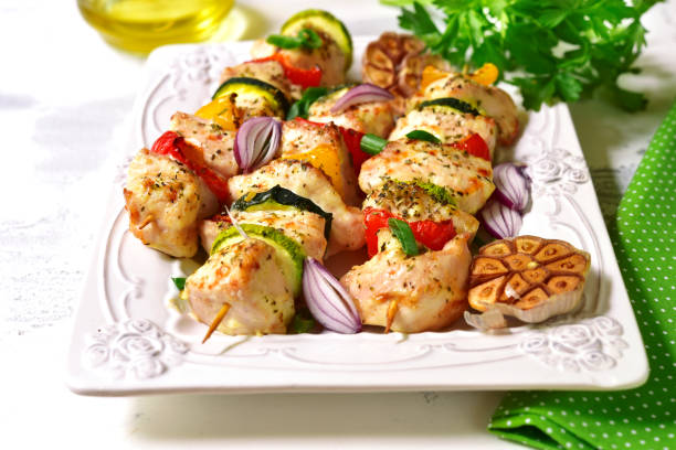 Grilled chicken kebab and vegetables stock photo