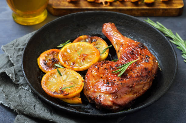 Grilled chicken leg stock photo