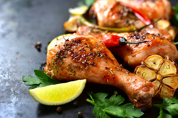 grilled chicken legs. - pepper seasoning stock photos and pictures