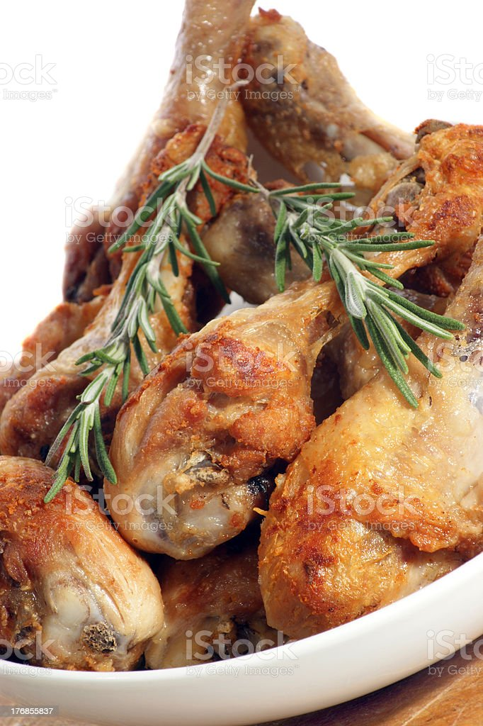 grilled chicken legs with rosemary in a white bowl royalty-free stock photo