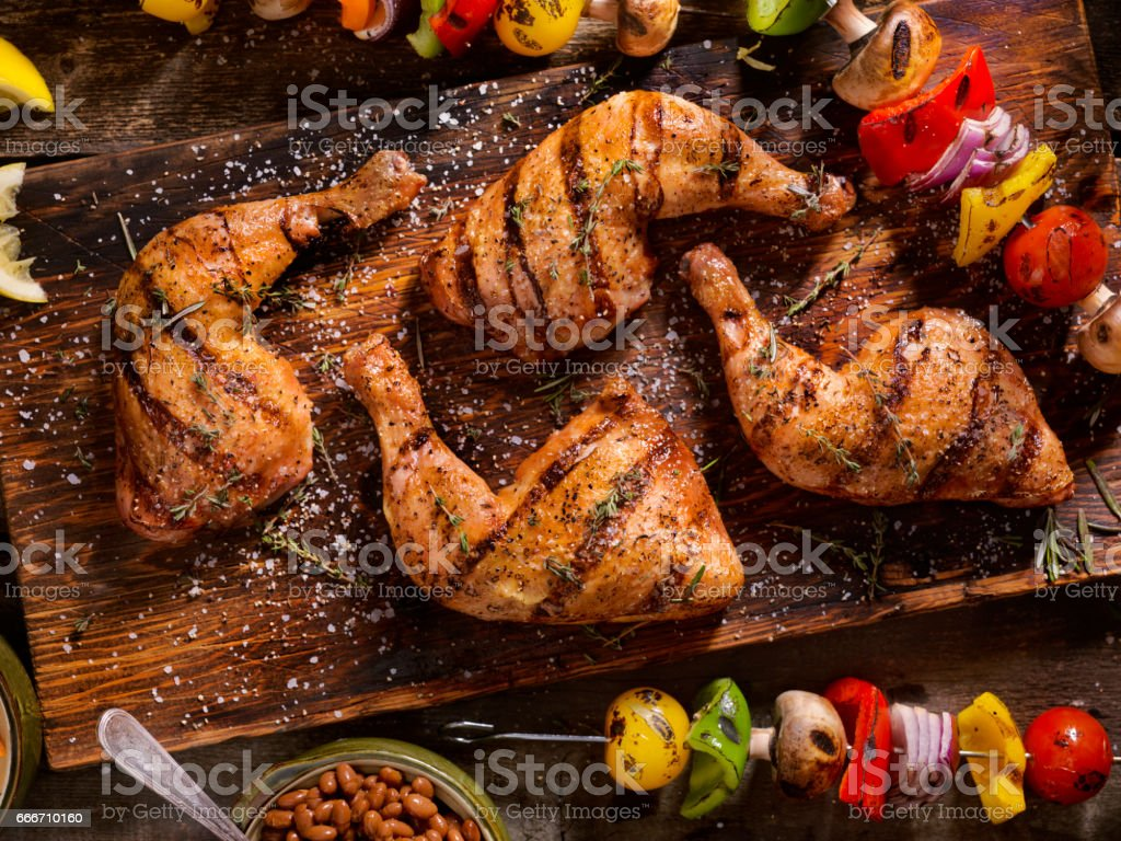 Grilled Chicken Legs With Vegetable Skewers stock photo