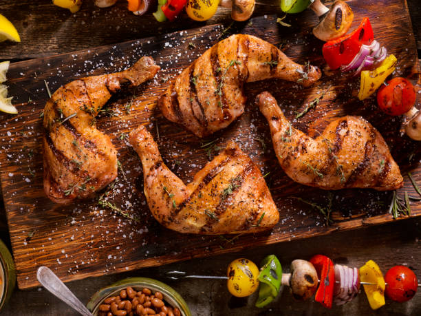 Grilled Chicken Legs With Vegetable Skewers Grilled Chicken Legs With Vegetable Skewers, Baked Beans and Coleslaw drumstick stock pictures, royalty-free photos & images
