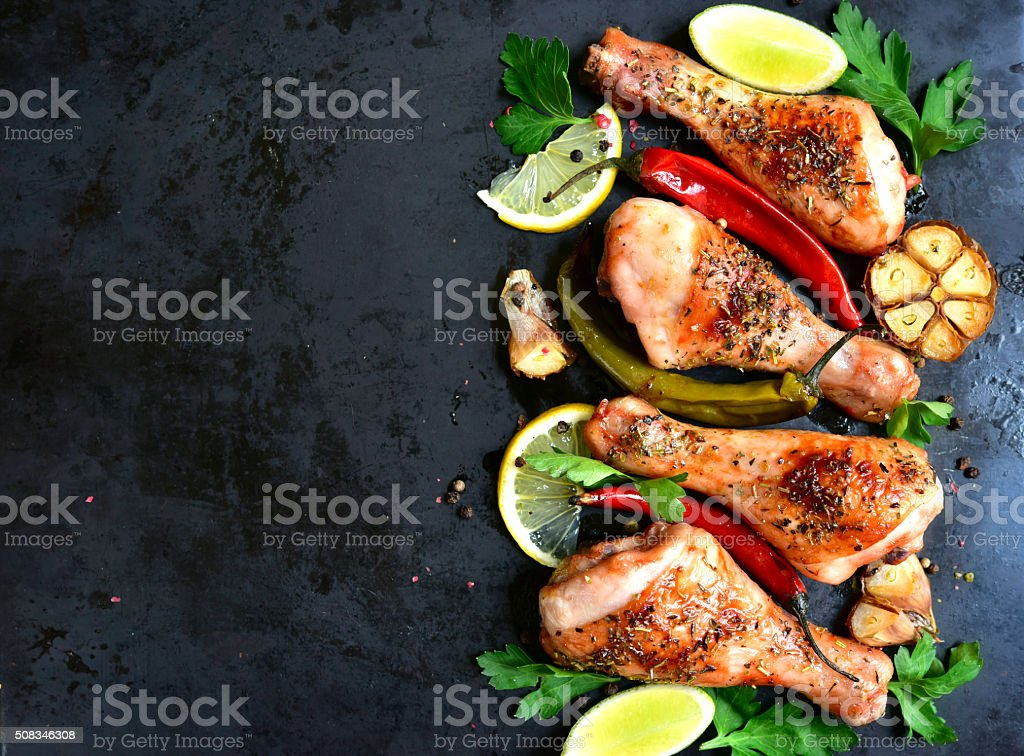 Grilled chicken legs.Top view.Copy space background. stock photo