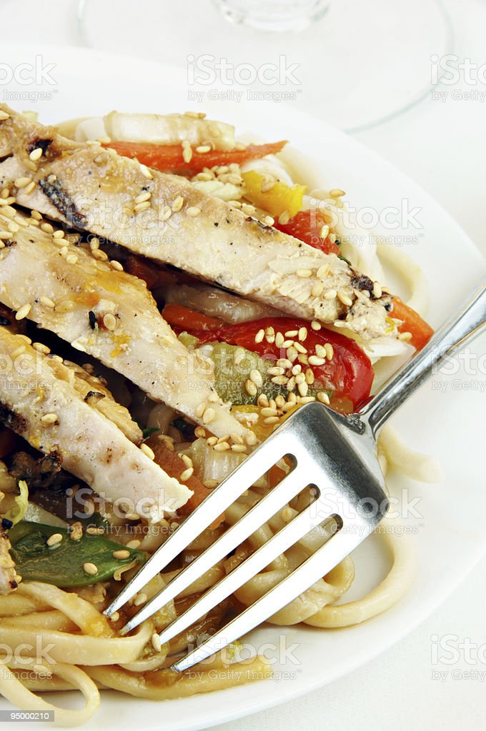 Grilled Chicken on Udon Noodles with Vegetables royalty-free stock photo