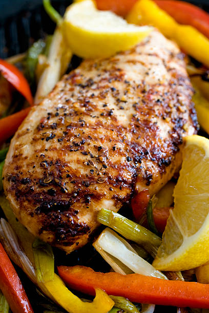 Grilled Chicken Grilled chicken  and  peppers. macro, shallow focus. grilled chicken breast stock pictures, royalty-free photos & images