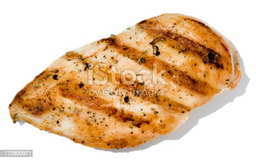 Broiled seasoned Chicken isolated on white.