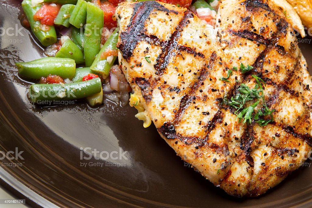 Grilled Chicken Plate with French Fries stock photo