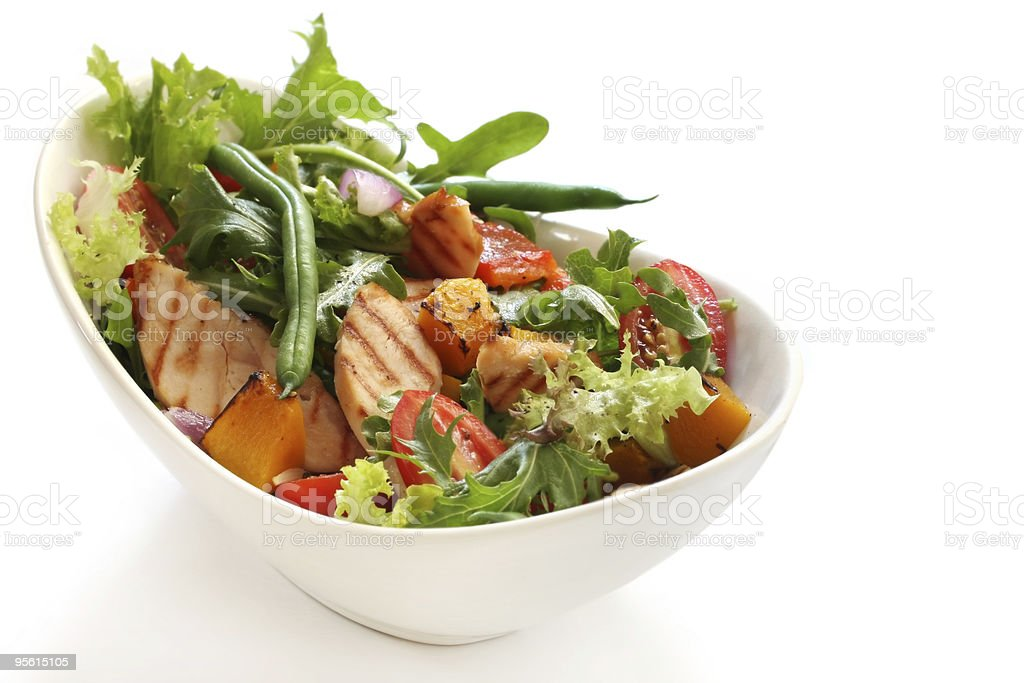 A grilled chicken salad in a bowl stock photo
