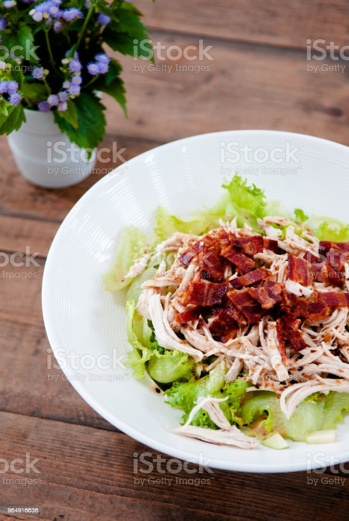 Grilled chicken Salad with green lettuce in white plate on wood table top view shot royalty-free stock photo