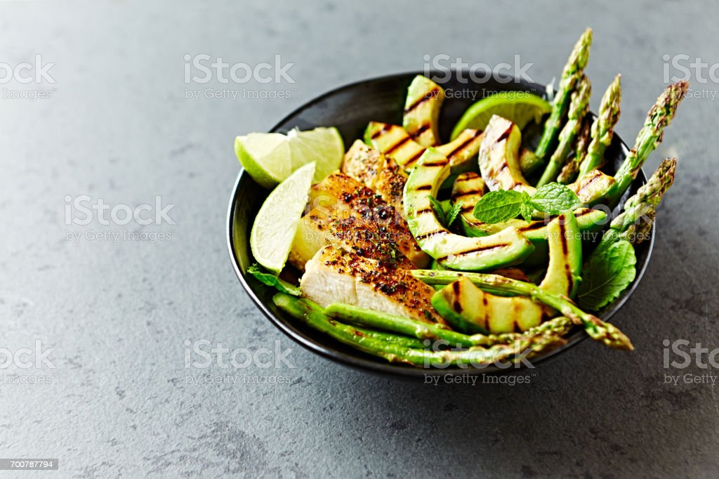 Grilled Chicken Salad with Grilled Avocado and Asparagus stock photo