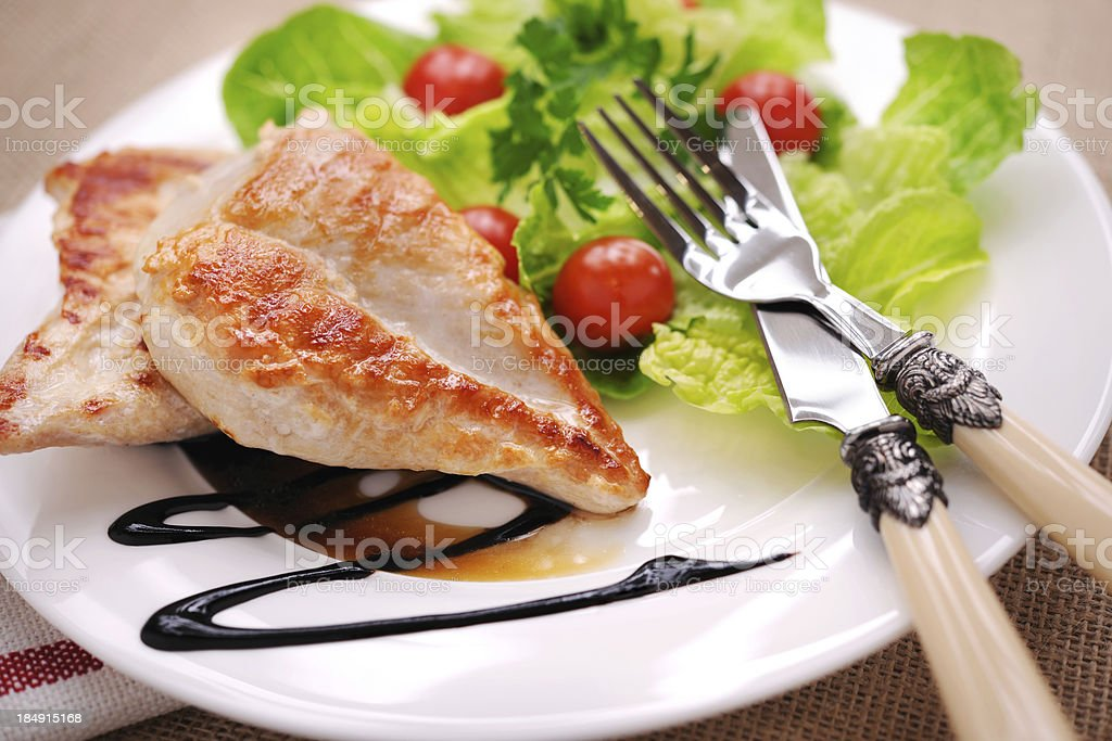 Grilled chicken steak with salad and balsamic vinegar stock photo