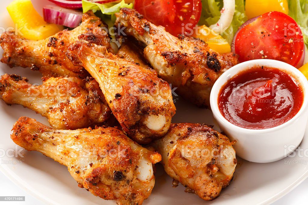 Grilled chicken wings and vegetables stock photo