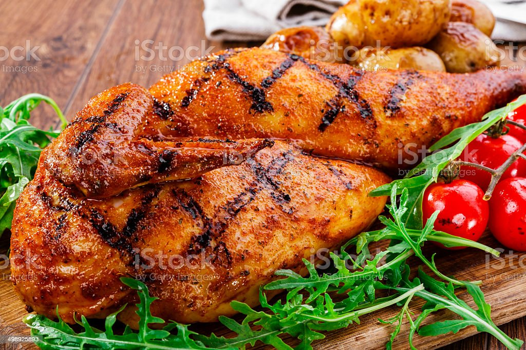 grilled chicken with potatoes half stock photo