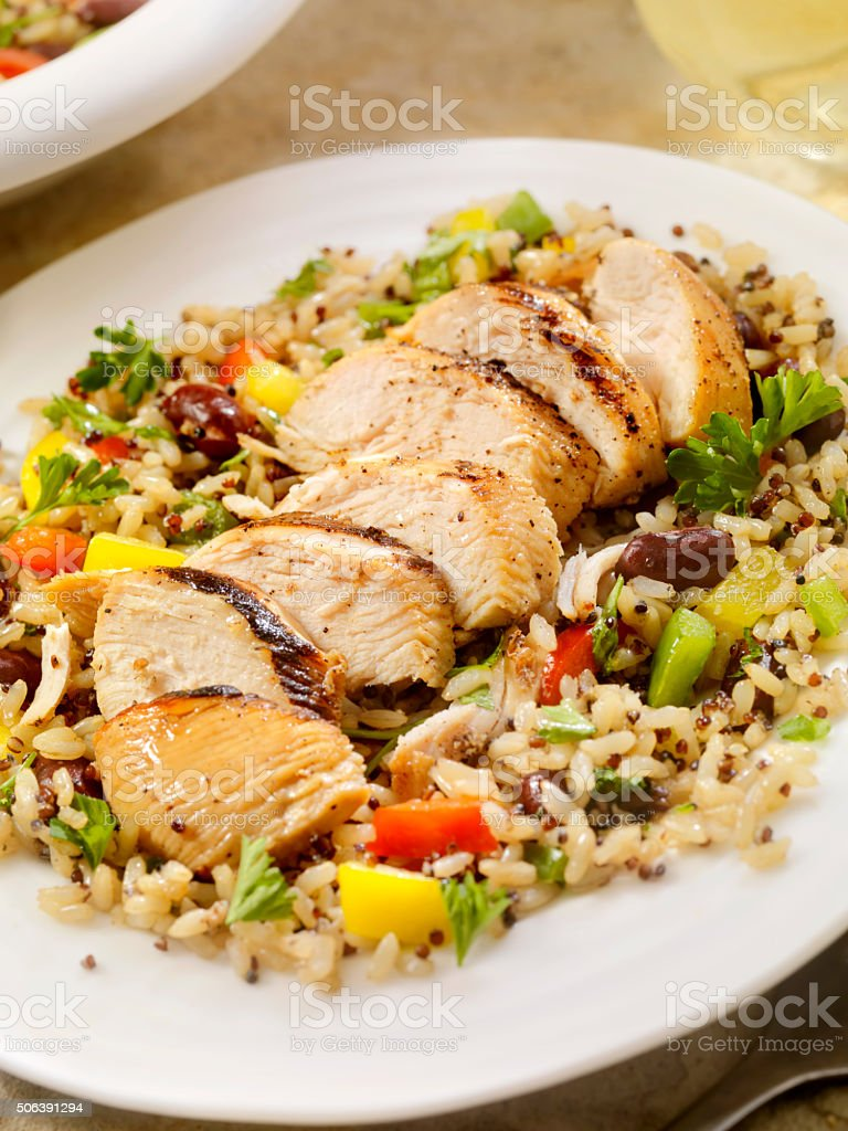 Grilled Chicken with Quinoa and Brown Rice Salad stock photo