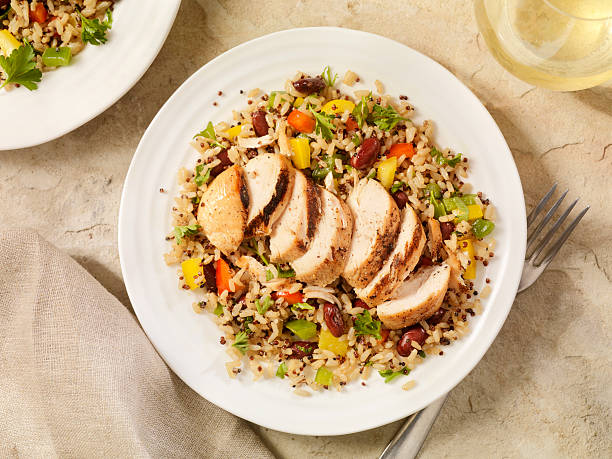 grilled chicken with quinoa and brown rice salad - quinoa stock photos and pictures
