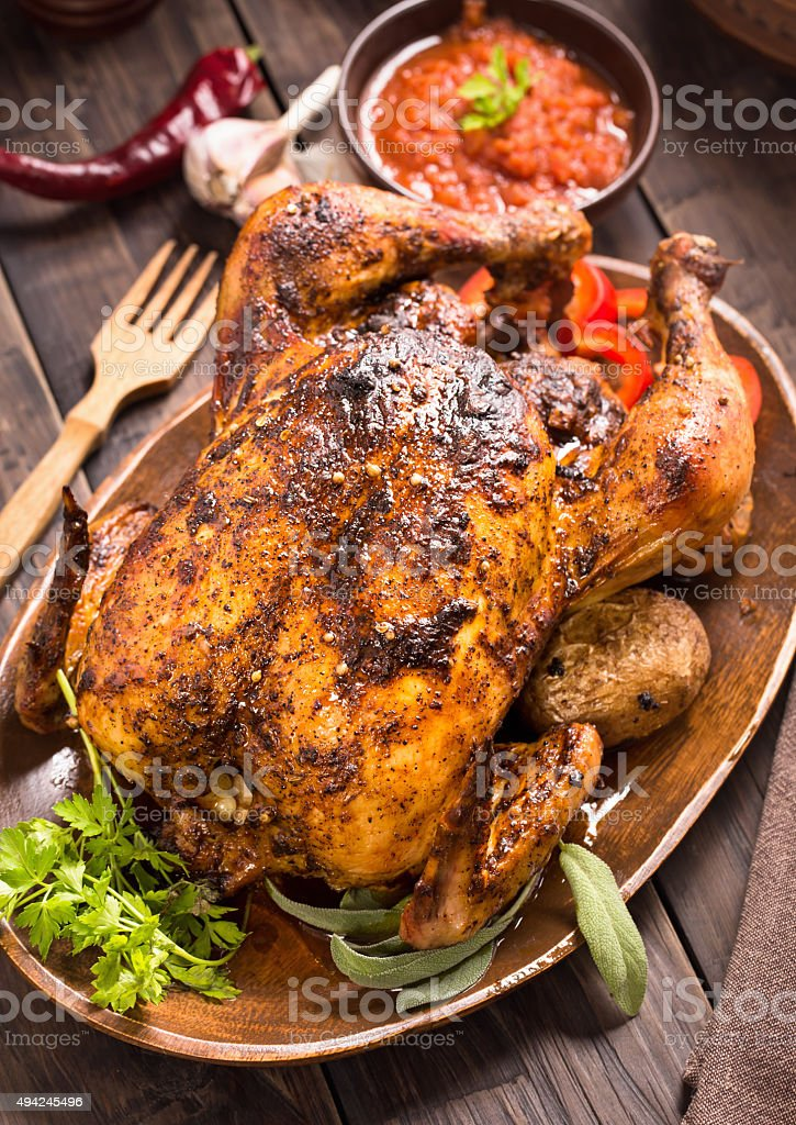Grilled chicken with vegetables on wooden plate stock photo