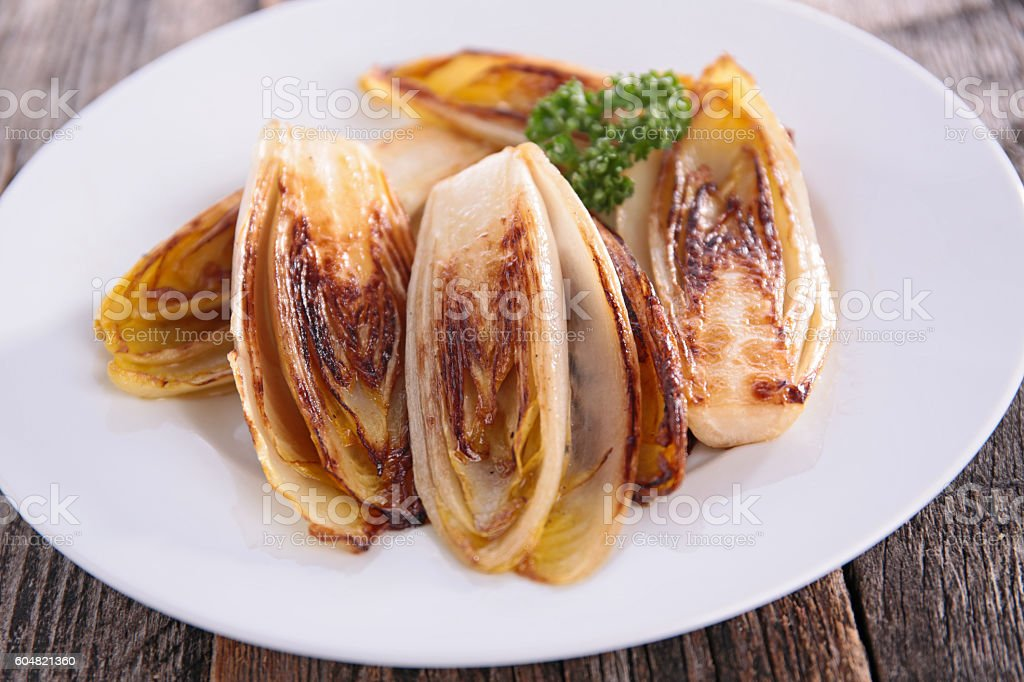 grilled chicory stock photo