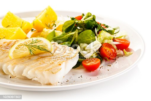 istock Grilled cod fillet with fried potatoes and vegetables 1029397302