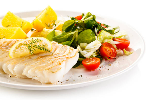grilled cod fillet with fried potatoes and vegetables - cod imagens e fotografias de stock