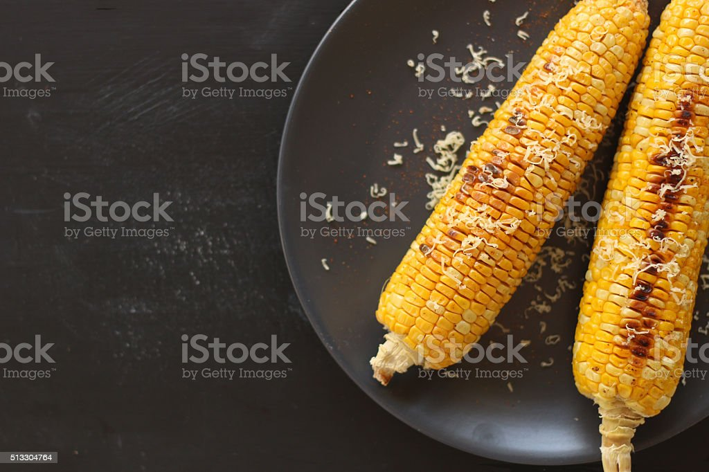 Grilled corn cobs on black background stock photo