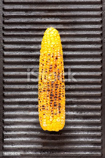 Corn on the cob over iron grill