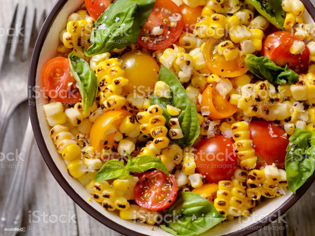 Grilled Corn Salad with Tomatoes and Basil stock photo