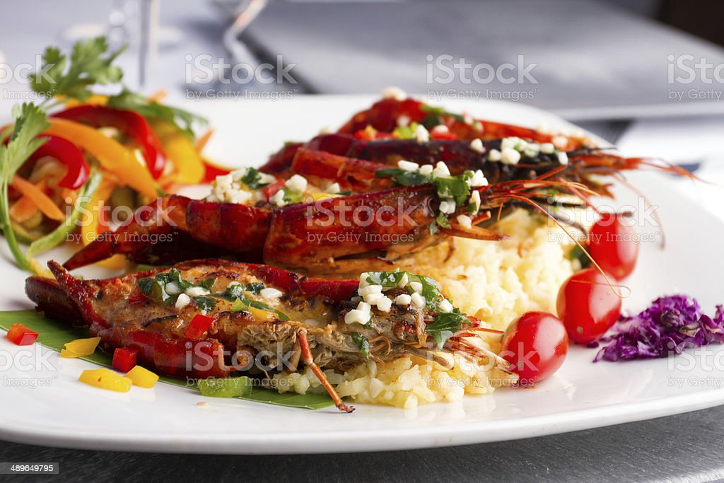 Grilled Crawfish Dinner Over Rice stock photo