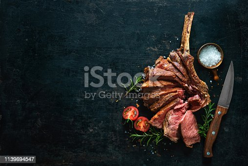 istock Grilled dry aged tomahawk steak sliced as close-up 1139694547